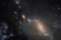 科技资讯看点:哈勃太空望远镜观看两个星系合并NGC3447